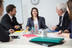 Young smiling businesswoman on funny business meeting (photo: KatarzynaBialasiewicz)